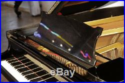 A 1952, Steinway Model O grand piano with a black case. 12 month warranty