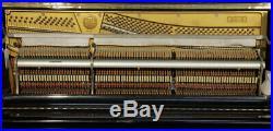 A 1968, Kawai KU-3 upright piano with a black case