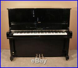 A 1969, Yamaha U3 upright piano with a black case. 3 year warranty