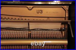 A 1973, Yamaha U3 upright piano with a black case. 3 year warrranty