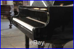 A 1974, Yamaha G2 grand piano with a black case and spade legs. 3 year warranty