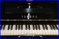 A 1975, Yamaha U1 upright piano with a black case. 3 year warranty