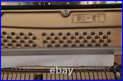 A 1976, Kawai BL-61 upright piano with a black case. 3 year warranty