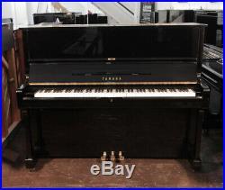 A 1976, Yamaha U1 upright piano with a black case. 3 year warranty