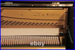 A 1977, Yamaha U1 upright piano with a black case. 3 year warranty