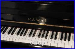 A 1978, Kawai KU-1B upright piano with a black case. 3 year warranty
