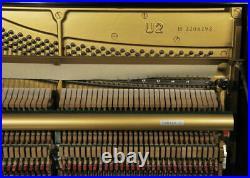 A 1980, Yamaha U2 upright piano with a black case. 3 year warranty