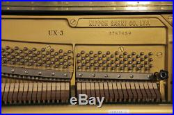 A 1983, Yamaha UX-3 upright piano for sale with a black case and brass fittings