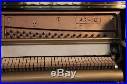 A 1985, Kawai NS-10 upright piano with a black case. 3 year warranty