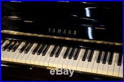 A 1986, Yamaha U1A upright piano with a black case. 3 year warranty