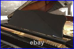 A 1989, Yamaha G2 grand piano with a black case. 3 year warranty