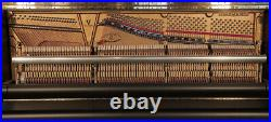 A 1998, Steinway Model V upright piano with a satin, black case. 3 year warranty
