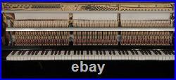 A 2000, Kawai CX-5H upright piano with a black case