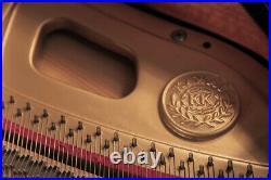 A 2003, Kawai GM-10 baby grand piano with a black case. 3 year warranty