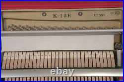 A 2006, Kawai K-15E upright piano with a black case. 3 year warranty