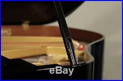 A 2014, Kawai GM-10 baby grand piano with a black case. 3 year warranty