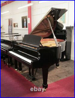 A 2016, W. Hoffmann grand piano with a black case. 5 year warranty