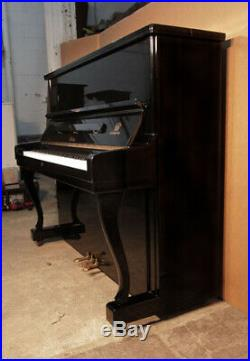 Atlas Mod A20 upright piano with a black case and cabriole legs. 12month warranty
