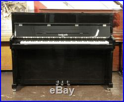 Brand new, Besbrode SU 113 upright piano with a black case. 5 year warranty