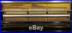 Karl Muller Upright Piano with a Black Case and Brass Fittings