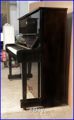Kawai BL-11 upright piano with a black case. 12 month warranty