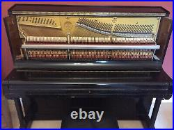 Montague Upright Piano. Black wooden case with metal pin block. Fully working