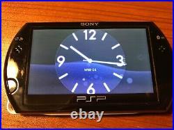 PSP Go (16GB, Black, 6.61) with Case + 2GB Memory Stick (M2)