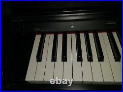 Roland LX-7 Digital Piano. Black wooden case. Fully adjustable Stool