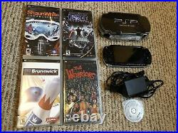 Sony PSP 2000 Black With Charger, Hard Case, 4GB Memory, And 5 Games The Warriors