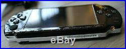 Sony PSP 2003 Slim Piano Black With 7 Games (Grand Theft Auto) & Case