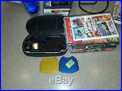 Sony PSP 3001 Black, 2GB memory Card, Charger, PSP Case, god of war and more