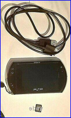 Sony PSP Go 16GB Handheld System Piano Black with case, charger + 2GB Sony M2 Car
