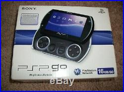 Sony PSP Go Launch Edition 16GB Piano Black Handheld System, Charger, Case, Games