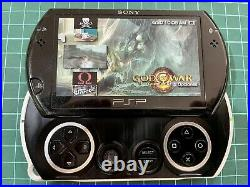 Sony PSP Go Piano Black Handheld System + 15 Games + Sony Charger + Travel Case
