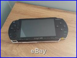 Sony PSP Piano Black With Charger And Bag + hard case inc. 3 films and 2 games