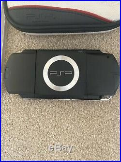 Sony PSP console 1003 piano black with 6 games, case and power supply (2)