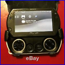 Sony PSP go 16GB Piano Black Handheld System With Charger, and Case