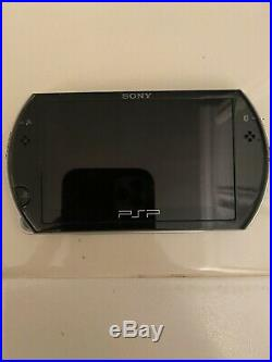 Sony PSP go Launch Edition Piano Black Handheld System With Sony Case