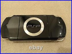 Sony PlayStation Portable PSP 2003 Slim & Lite Piano Black + Case + 4GB Memory