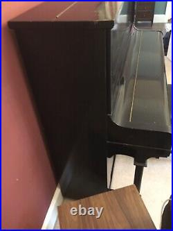 Upright Piano Serviced & Fully Working. Black wooden case with metal pin block