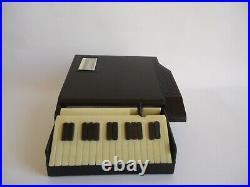 VINTAGE TABLE CIGARETTE DISPENSER/CASE'' ROYAL/PIANO -1960's