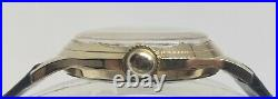 Vintage Gruen 415, exquisite piano black dial and gold plated scalloped case