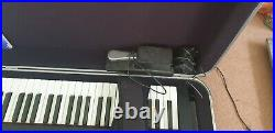 Yamaha CP33 stage piano with flight case and accessories