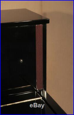 Yamaha LX-113 upright piano with a black case and walnut detail. 3 year warranty