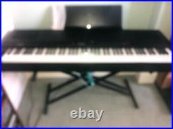 Yamaha electric keyboard piano (88 keys) with customised flight case